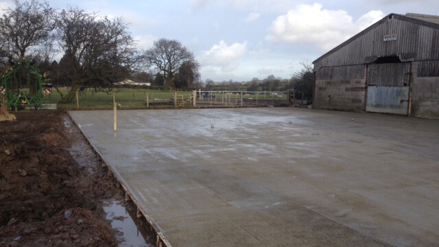 The installation of a 20m x 60m concrete farmyard with patterned grip imprint finish